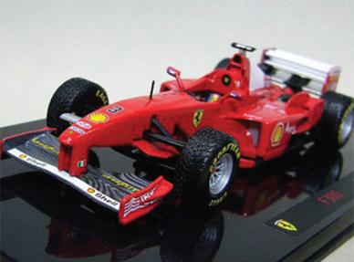 Масштаб: 1:43.  Фирменный стиль.  Модель Ferrari F300, Михаэль Шумахер...